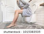 brunette woman sitting on... | Shutterstock . vector #1015383535