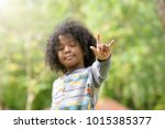 mixed race boy show i love you... | Shutterstock . vector #1015385377