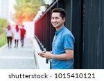 handsome modern man using... | Shutterstock . vector #1015410121