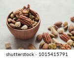 mixed nuts in wooden bowl ... | Shutterstock . vector #1015415791