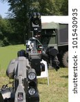 Small photo of Military equipment defensive technique robots camouflage trunks defense attacks air forces exhibition soldiers landscape