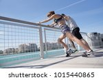 joggers stretching out after... | Shutterstock . vector #1015440865