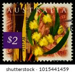 """Small photo of Moscow, Russia - January 22, 2018: A stamp printed in Australia shows Blackwood wattle flowers (Acacia melanoxylon), series """"Flora and Fauna"""", circa 1996"""