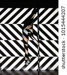 beautiful woman dances near a... | Shutterstock . vector #1015444207