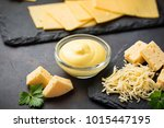 homemade cheese sauce in glass... | Shutterstock . vector #1015447195