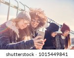 young people wasting time... | Shutterstock . vector #1015449841