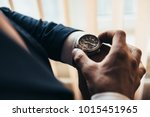 a stylish mechanical watch on... | Shutterstock . vector #1015451965