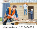 carpenter at construction site... | Shutterstock . vector #1015466551