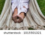 curled toes of little girl in... | Shutterstock . vector #1015501321