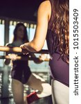 Small photo of Young dancer in bodysuit and with long hair training with barre in sunlight.