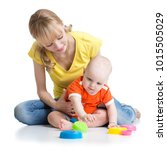 baby and momy playing together... | Shutterstock . vector #1015505029