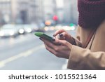 girl using cellphone while... | Shutterstock . vector #1015521364