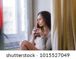 woman hold cup of hot drink... | Shutterstock . vector #1015527049