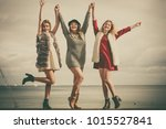 three fashionable women having... | Shutterstock . vector #1015527841
