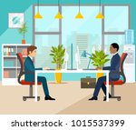 two businesspeople in office....   Shutterstock .eps vector #1015537399