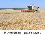 grain harvesting combine | Shutterstock . vector #1015542259