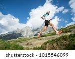 a trail runner running along... | Shutterstock . vector #1015546099
