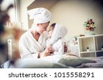 Small photo of Mother and daughter share love between etch other.