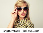 glamour girl in shades looking... | Shutterstock . vector #1015562305