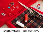 sew clothes and a red dress.... | Shutterstock . vector #1015593097