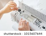 young seamstress adjusts the... | Shutterstock . vector #1015607644