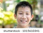 happy smily face asian girl... | Shutterstock . vector #1015610341