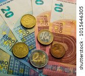 paper euro banknotes and coins. ... | Shutterstock . vector #1015646305