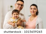family  parenthood and people... | Shutterstock . vector #1015659265