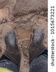 in rubber boots on dirt  at the ... | Shutterstock . vector #1015673221