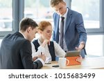 young business team working on... | Shutterstock . vector #1015683499