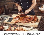 chef hands cutting whole... | Shutterstock . vector #1015690765