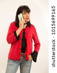 lady talking on the phone with... | Shutterstock . vector #1015699165
