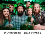 a company of young people... | Shutterstock . vector #1015699561