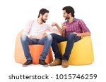 two friends sitting on beanbags ... | Shutterstock . vector #1015746259