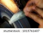 knife sharpening sparks | Shutterstock . vector #1015761607