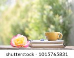 yellow cup with yellow rose and ... | Shutterstock . vector #1015765831