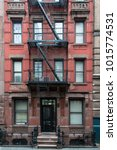 all red brick apartment... | Shutterstock . vector #1015774531