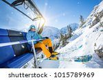 skier sitting at ski lift in...   Shutterstock . vector #1015789969