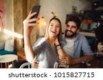 young attractive couple making... | Shutterstock . vector #1015827715