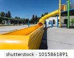 yellow waterslide at an outdoor ... | Shutterstock . vector #1015861891
