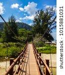 narrow wooden bridge that gives ... | Shutterstock . vector #1015881031