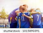 kids sport team having pep talk ... | Shutterstock . vector #1015890391