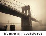 brooklyn bridge in a foggy day... | Shutterstock . vector #1015891531