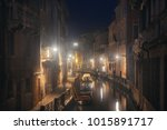 a misty night at venice canal... | Shutterstock . vector #1015891717