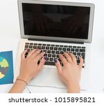 woman's hands typing on a... | Shutterstock . vector #1015895821