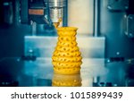 3d printer prints from the...   Shutterstock . vector #1015899439