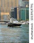 Small photo of DUBAI, UNITED ARAB EMIRATES - JUNE 25, 2016: Tourists aboard various ships enjoy beauty of famous Dubai Marina. Marina - artificial canal city, carved along a 3 km stretch of Persian Gulf shoreline.