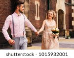 the guy in stylish clothes runs ... | Shutterstock . vector #1015932001