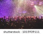 a crowded concert hall with... | Shutterstock . vector #1015939111