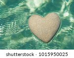 heart made of sand floating in... | Shutterstock . vector #1015950025